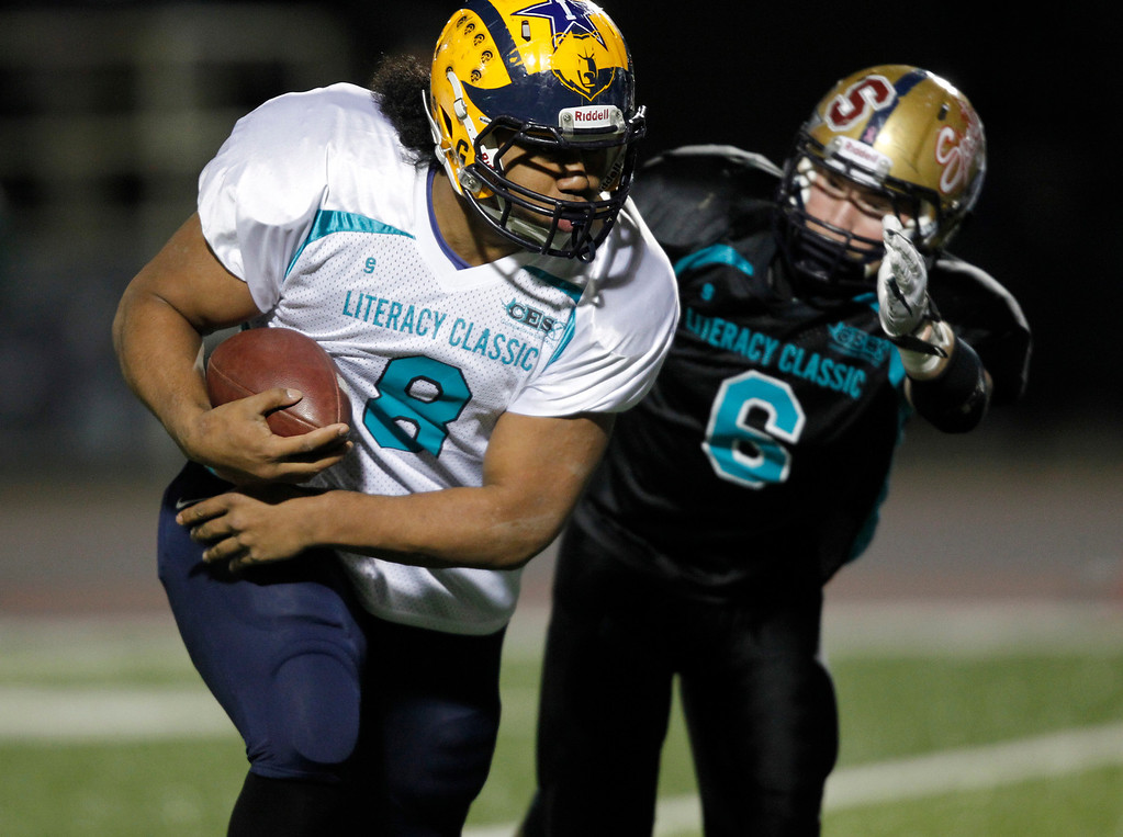 . The North\'s Vita Vea makes a run as he is pursued by the South\'s Kevin Kiff in the second quarter of the Literacy All-Star high school football game at San Jose City College in San Jose, Calif. on Saturday, Jan. 26, 2013. (Jim Gensheimer/Staff)