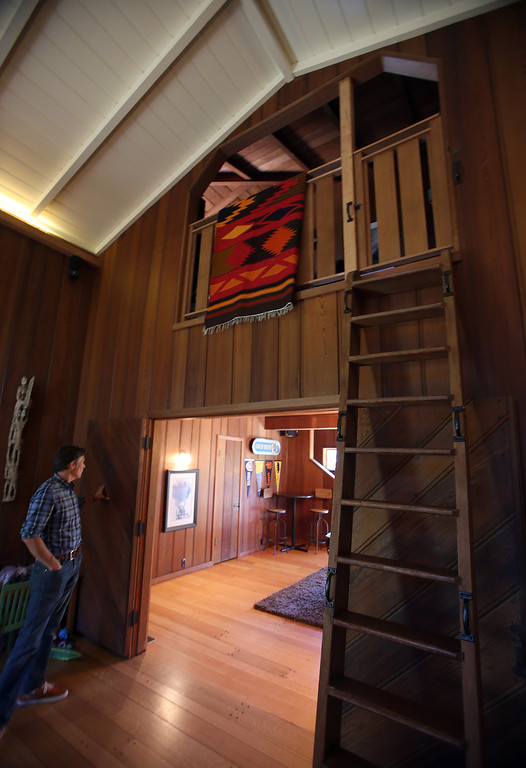 . Architect Gustave Carlson, of Gustave Carlson Design in Berkeley, gives a tour of a remodeled 1937 one-bedroom cabin is seen on Woodmont Avenue in Berkeley, Calif., on Thursday, July 25, 2013. Carlson managed the project. (Jane Tyska/Bay Area News Group)