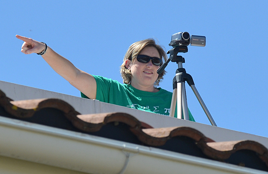 . Martinez Junior High School math teacher Lexy Tamony stands on top of the roof at Martinez Junior High School in Martinez with a video camera as she tells all 880 students to look up while they were creating a video to send well wishes to fellow student Aaron Hern in Martinez, Calif., on Friday, April 19, 2013. Hern is recovering in Boston at Children\'s Hospital after being severely injured at the Boston Marathon explosion last Monday. (Dan Rosenstrauch/Bay Area News Group)