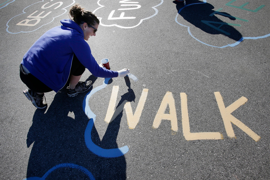 . Jaclyn O\'Brien repaints the playground at Ryan Elementary School during a Dr. Martin Luther King Jr. day-of-service activity by Kaiser Permanente volunteers in San Jose, Calif. on Monday, January 21, 2013.   (Gary Reyes/ Staff)