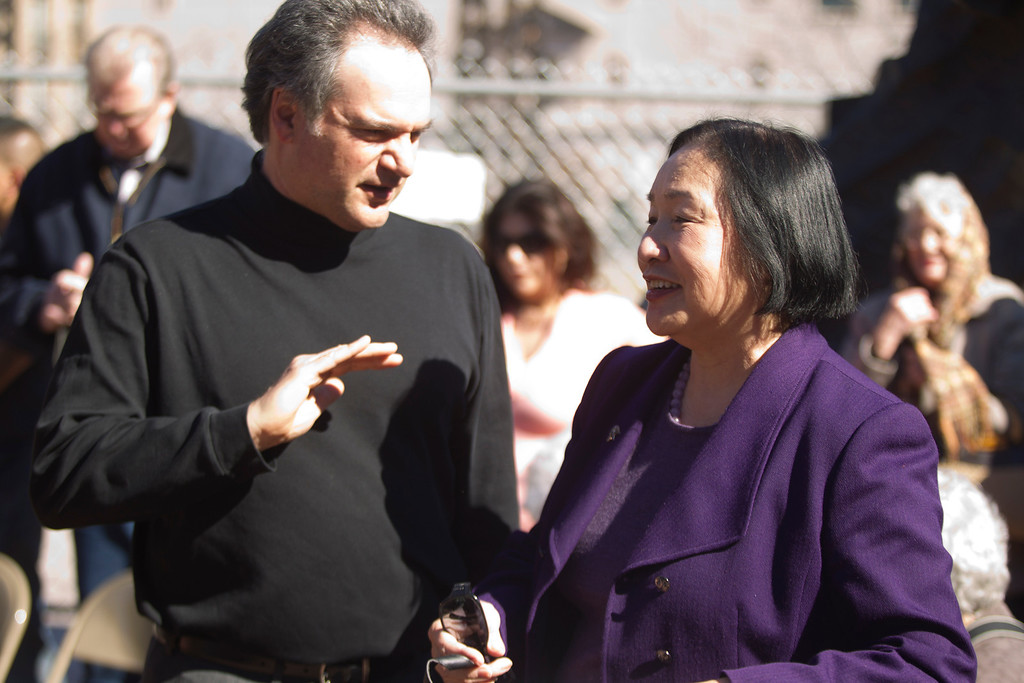 ". Artist Mario Chiodo, left, and Oakland, Calif. Mayor Jean Quan chat before the start of a ceremony to dedicate the final section of ""Remember Them,\"" Chiodo\'s paean to heroes of civil rights and humanity, Thursday, Feb. 21, 2013 in Oakland Calif. (D. Ross Cameron/Staff)"