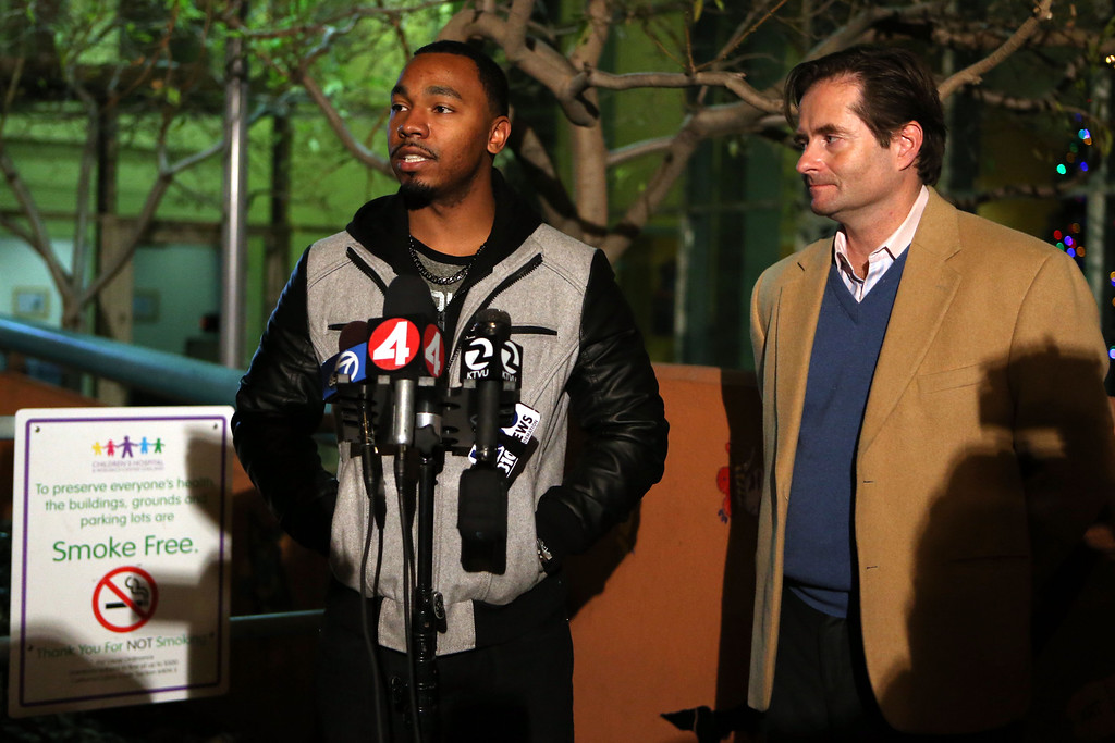 . Omari Sealey, left, uncle of 13-year-old Jahi McMath, and family attorney Chris Dolan say that Sealey\'s niece will be moved to an undisclosed location in the Bay Area during a news conference outside Children\'s Hospital Oakland, Calif., on Thursday, Dec. 26, 2013.  (Ray Chavez/Bay Area News Group)