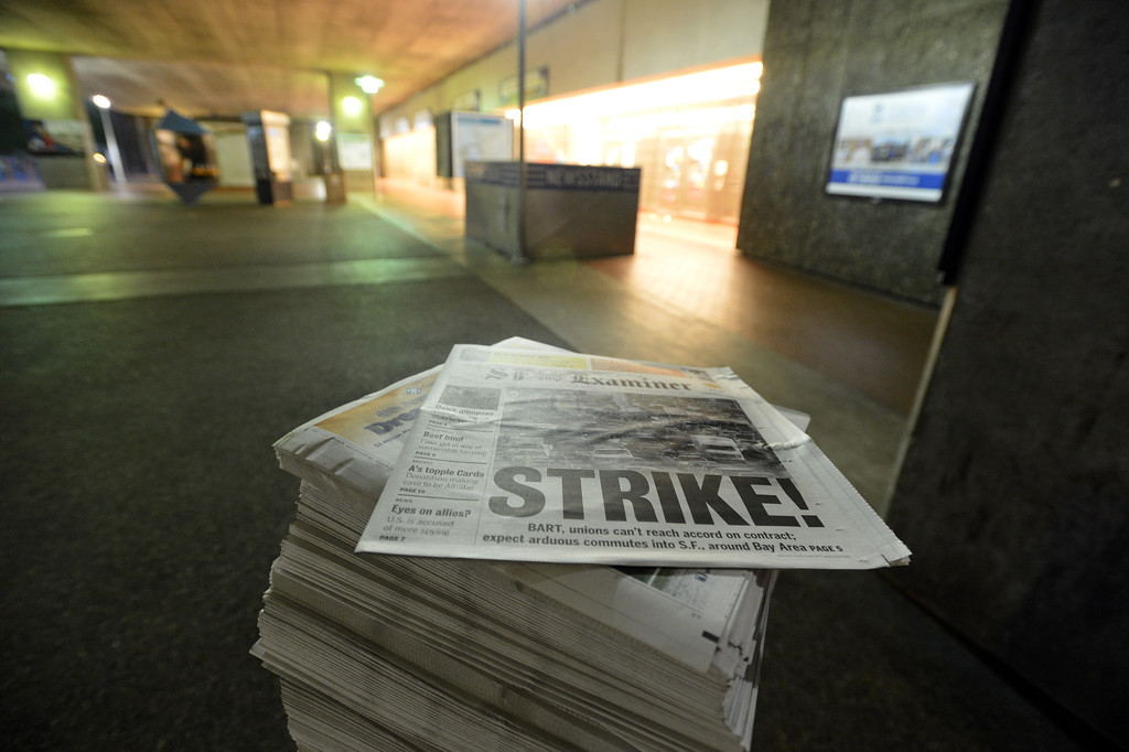 . A stack of newspapers and an empty station tell the story at the MacArthur BART station in Oakland, Calif. on Monday, July 1, 2013. (Kristopher Skinner/Bay Area News Group)