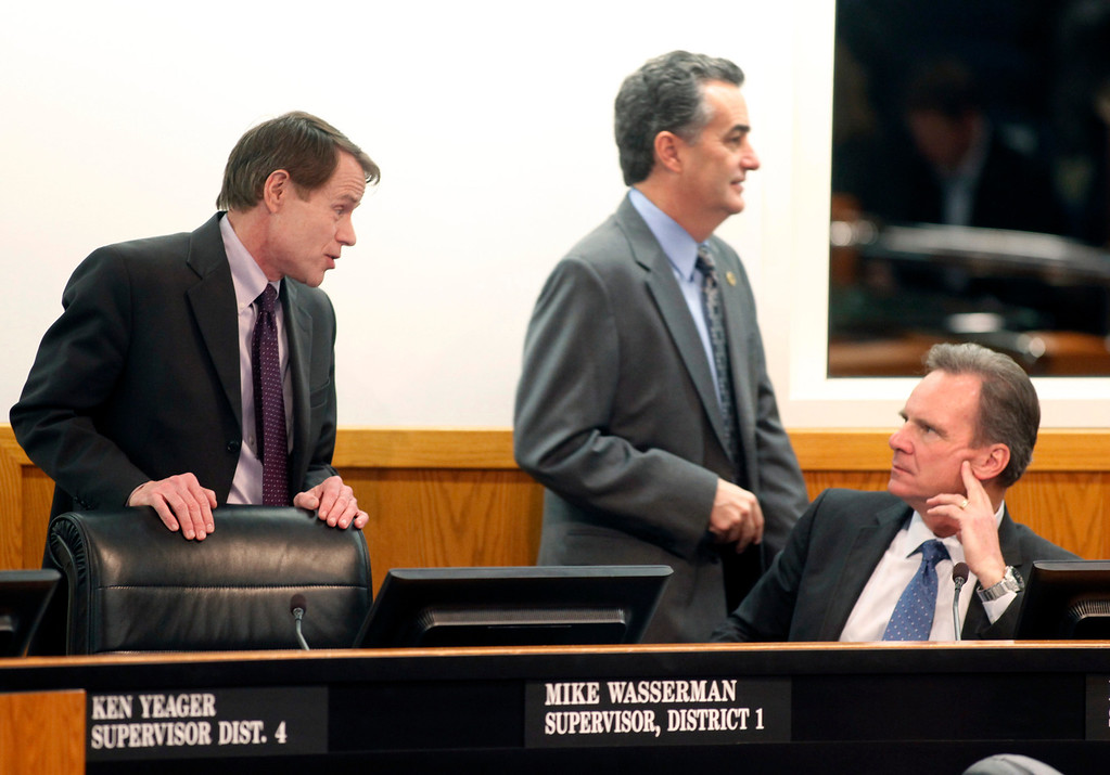 . Supervisor Ken Yeager, president of the County of Santa Clara Board of Supervisors speaks with Supervisor Dave Cortese as Supervisor Mike Wasserman walks by before the 2013 State of the County Address in the Board Chambers on Tuesday Jan. 29, 2013 in San Jose, Calif. (Karl Mondon/Staff)
