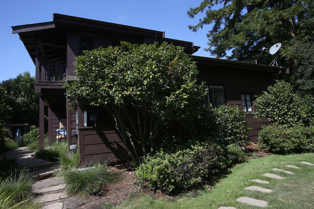 . The exterior of a remodeled 1937 one-bedroom cabin is seen on Woodmont Avenue in Berkeley, Calif., on Thursday, July 25, 2013.  Architect Gustave Carlson, of Gustave Carlson Design in Berkeley, managed the project. (Jane Tyska/Bay Area News Group)