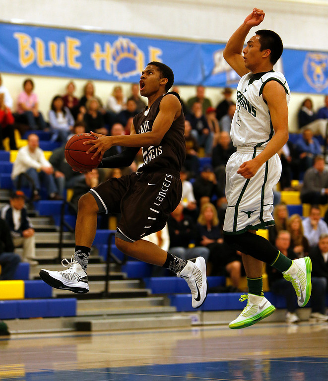 . St. Francis High School\'s Khalil Johnson (23) takes a shot against Leigh High School\'s Kimo Francisco (2) in the first period for the CCS Division II Boys Basketball semifinals at Santa Clara High School in Santa Clara, Calif., on Tuesday, Feb. 26, 2013.  (Nhat V. Meyer/Staff)
