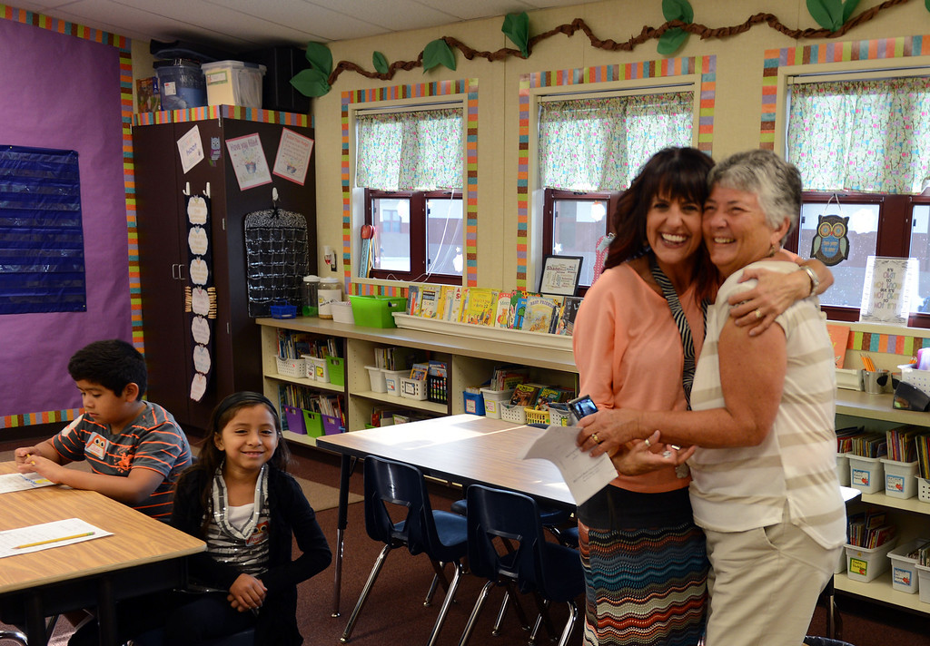 . On a mission to visit every classroom on the new campus, Mary Casey Black, right, gets a welcoming hug from third grade teacher Mrs. Debbie Burns at the start of school in one of the brand new classrooms on the first day of school at Mary Casey Black Elementary School in Brentwood, Calif., on Tuesday, July 30, 2013.  Before having the new school named in her honor, Casey Black taught at various schools in Brentwood and was a principal.  (Susan Tripp Pollard/Bay Area News Group)
