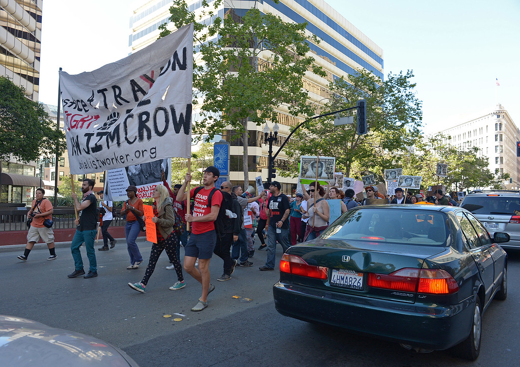 . Protesters march on Broadway as they stop traffic in Oakland, Calif., on Sunday, July 14, 2013. A Florida jury ruled Saturday that defendant George Zimmerman has been found not guilty in the shooting death of Trayvon Martin. (Jose Carlos Fajardo/Bay Area News Group)