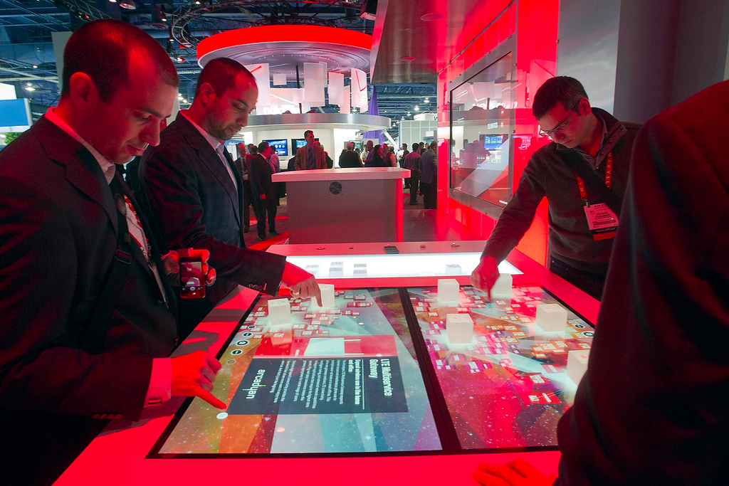 . Show-goers play with an interactive exhibit at the Verizon booth during the first day of the Consumer Electronics Show (CES) in Las Vegas January 8, 2013. (REUTERS/Steve Marcus)