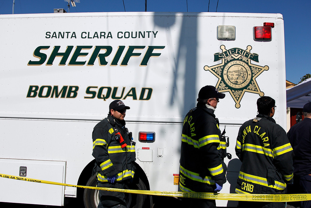 . Members of the Santa Clara County Fire Department help the Santa Clara County Sheriff\'s Bomb Squad during the search for explosive materials at Everett Basham\'s house on Humbolt Ave., in Santa Clara, Calif. on Wednesday, Feb. 13, 2013.   (LiPo Ching/Staff)