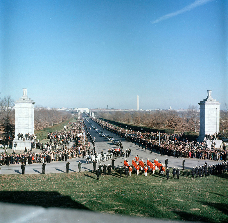 . Funeral procession of President John F. Kennedy nears Arlington National Cemetery, Arlington, Va., Nov. 25, 1963. In the background, from left, the Lincoln Memorial, the Washington Monument and the dome of the Capitol building can be seen.   (AP Photo)