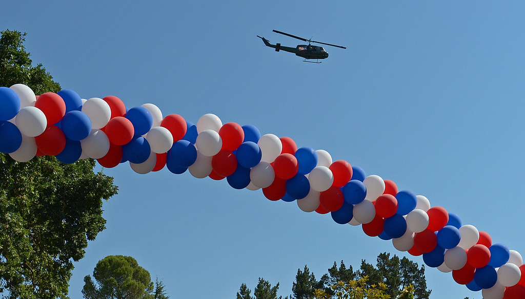 . A Huey helicopter performs a fly-over during the 30th anniversary Lamorinda Fourth of July parade and celebration on Thursday, July 4, 2013. (Jose Carlos Fajardo/Bay Area News Group)