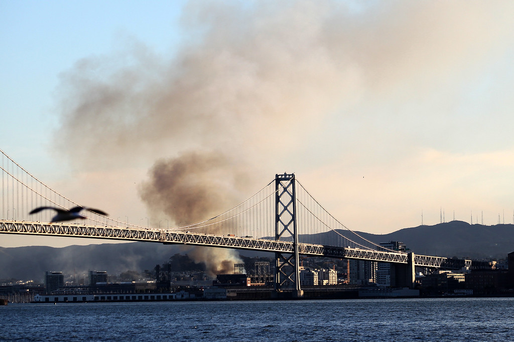 . A plume of smoke from a 5-alarm fire on an apartment complex under construction at Fourth Street near China Basin in San Francisco, Calif., in seen from Ttreasure island as San Francisco firefighters battle the fire on Tuesday, March 11, 2014. (Ray Chavez/Bay Area New Group)