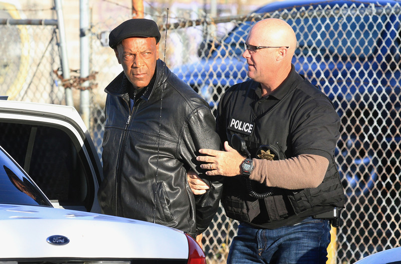 Basheer Fard Muhammad is taken into custody in front of Elijah's University and the headquarters of BMT International Security Services on 27th Street in Oakland, Calif., on Tuesday, Oct. 21, 2014.  (Laura A. Oda/Bay Area News Group)