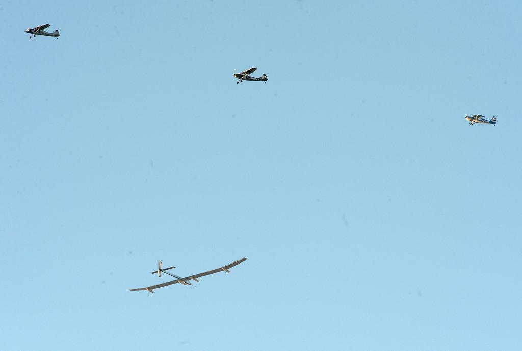 . Three planes fly near the solar driven airplane Solar Impulse as it flies over the San Francisco Bay on Tuesday, April 23, 2013. (Doug Duran/Bay Area News Group)