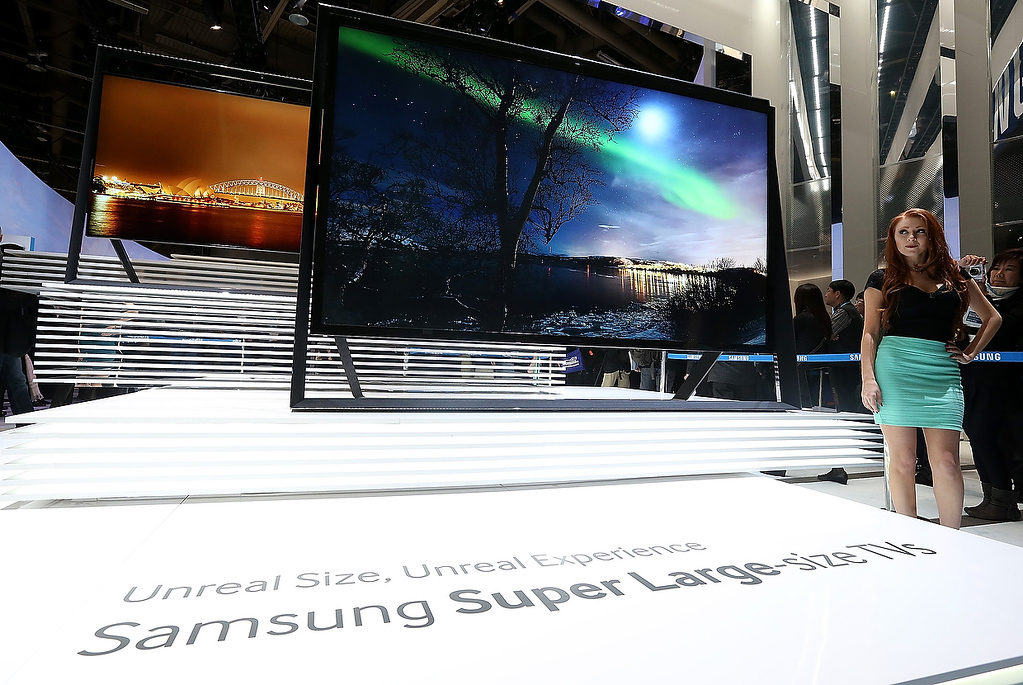 . A model stands next to a display of new large format Samsung televisions during the 2013 International CES at the Las Vegas Convention Center on January 8, 2013 in Las Vegas, Nevada. (Photo by Justin Sullivan/Getty Images)