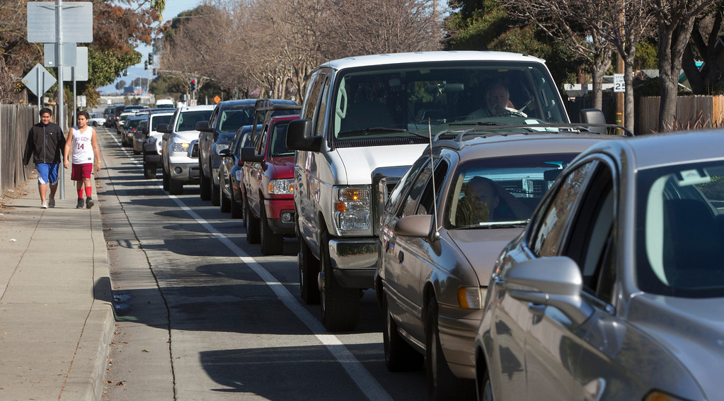 . People wait in cars on University Avenue for the gun buyback at East Palo Alto City Hall on Saturday, Feb. 23, 2013.The Peninsula cities of Palo Alto, Menlo Park and East Palo Alto police took part in the event with the help of the non-profit, Protect Our Children ,that provided the money for the buyback. Traffic in the area was snarled due to the large turn out of gun owners wanting to surrender their weapons. (John Green/Staff)