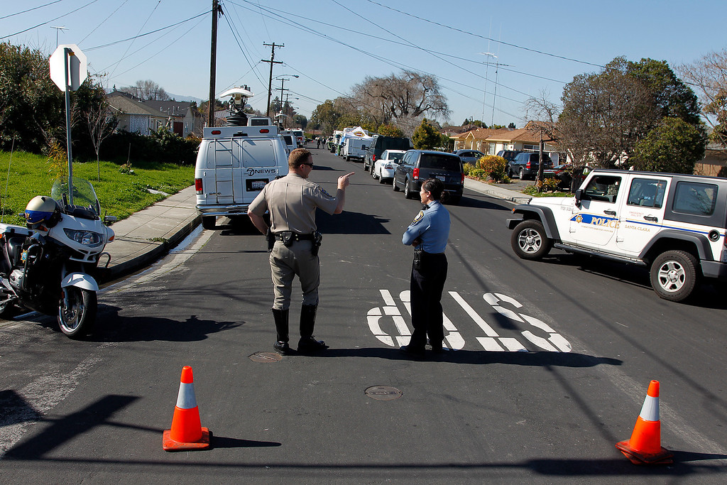 . The Santa Clara County Sheriff\'s Bomb Squad, Santa Clara County Fire Department, and the California Highway Patrol closed off Humbolt Ave., during the search for explosive materials at Everett Basham\'s house on Humbolt Ave., in Santa Clara, Calif. on Wednesday, Feb. 13, 2013.   (LiPo Ching/Staff)