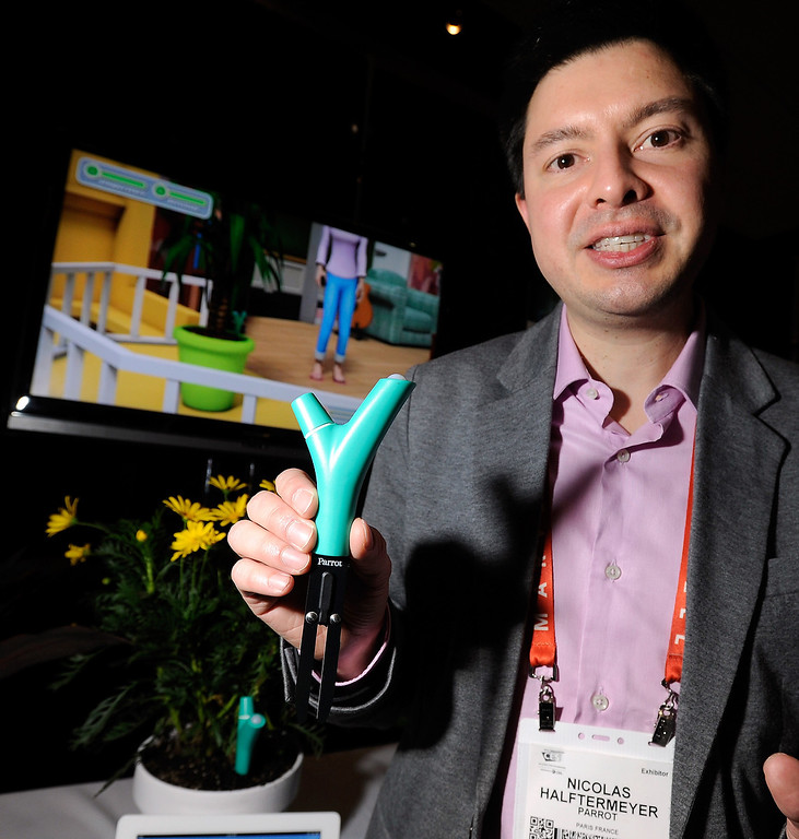 . Nicolas Halftermeyer of Parrot displays the Flower Power plant monitor during a press event at the Mandalay Bay Convention Center for the 2013 International CES on January 6, 2013 in Las Vegas, Nevada. The monitor will sense the plant\'s environment and relay the information to the user\'s smartphone. (Photo by David Becker/Getty Images)