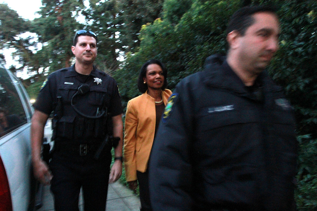 """. Condoleezza Rice is escorted by police officers to the Palo Alto home of Facebook CEO Mark Zukerberg to attend a campaign fundraiser for New Jersey Republican Gov. Chris Christie on Wednesday, Feb. 13, 2013. About 40 protesters rallied in front of the home, saying they objected to Christie�s visit because of his efforts to strip funding from Planned Parenthood and other women�s reproductive health care programs. Protester and Palo Alto resident Cheryl Lilienstein said she wondered whether Zuckerberg had any idea what Planned Parenthood means for women\'s health or what Christie�s stances are. \""""I hope he\'s just confused,\"""" she said. Zuckerberg and wife Priscilla Chan first got to know Christie after donating $100 million to struggling Newark, N.J., schools two years ago, according to a Facebook spokeswoman.   (Kirstina Sangsahachart/ Daily News)"""