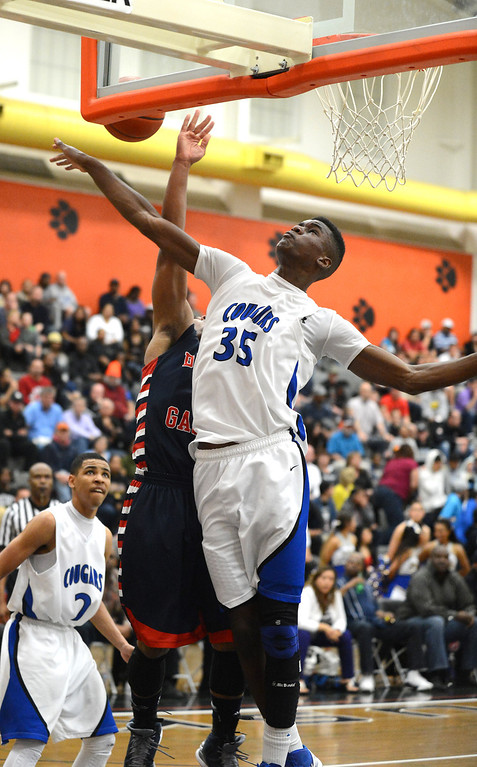 . Dublin High\'s Cameron Moses (2) has his shot blocked by Newark Memorial High\'s Matthew Thomas (35) in their North Coast Section Division II high school boys championship game played at Washington High School in Fremont, Calif. on Friday, March 1, 2013. (Dan Honda/Staff)