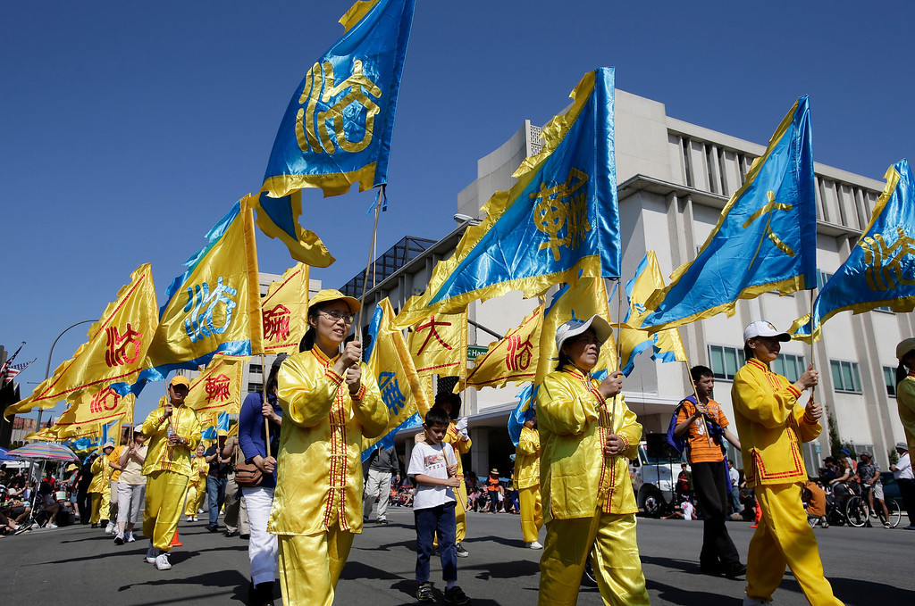 . Members of Falun Dafa participate in the annual Fourth of July parade in Redwood City, Calif. on Thursday, July 4, 2013. Considered the largest Independence Day parade in Northern California, it is celebrating its 75th year. (Gary Reyes/Bay Area News Group)