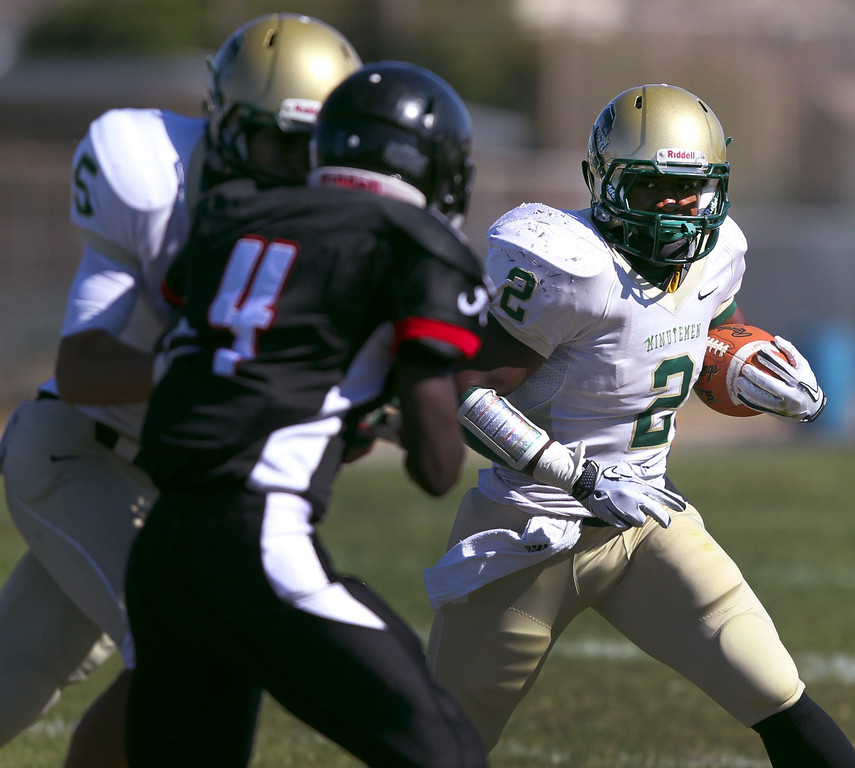 . <p>15. OLITO THOMPSON � RUNNING BACK � CONCORD</p> Thompson (2) gets a block from teammate Jacob Daynes (5) while running against Arroyo\'s DeJon Savage (4) in the first quarter of their high school football game in San Lorenzo, Calif., on Friday, September 7, 2012. (Anda Chu/Staff)