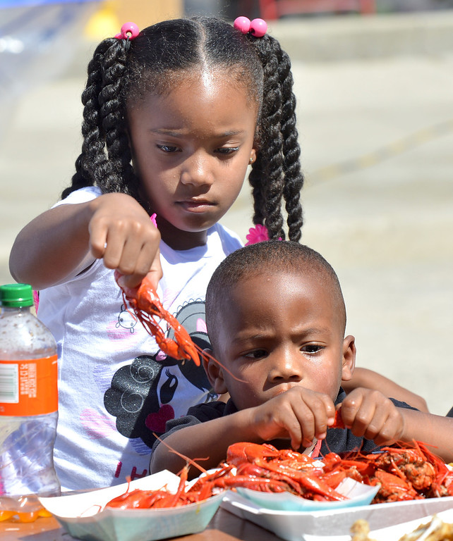 . Maleah Barnes, 6, of San Francisco, left, and her brother Makaih Barnes, 3, enjoy a plate full of crawdads at the 29th annual Pittsburg Seafood and Music Festival in the city\'s historic Old Town in Pittsburg, Calif., on Saturday, Sept. 7, 2013. (Dan Rosenstrauch/Bay Area News Group)