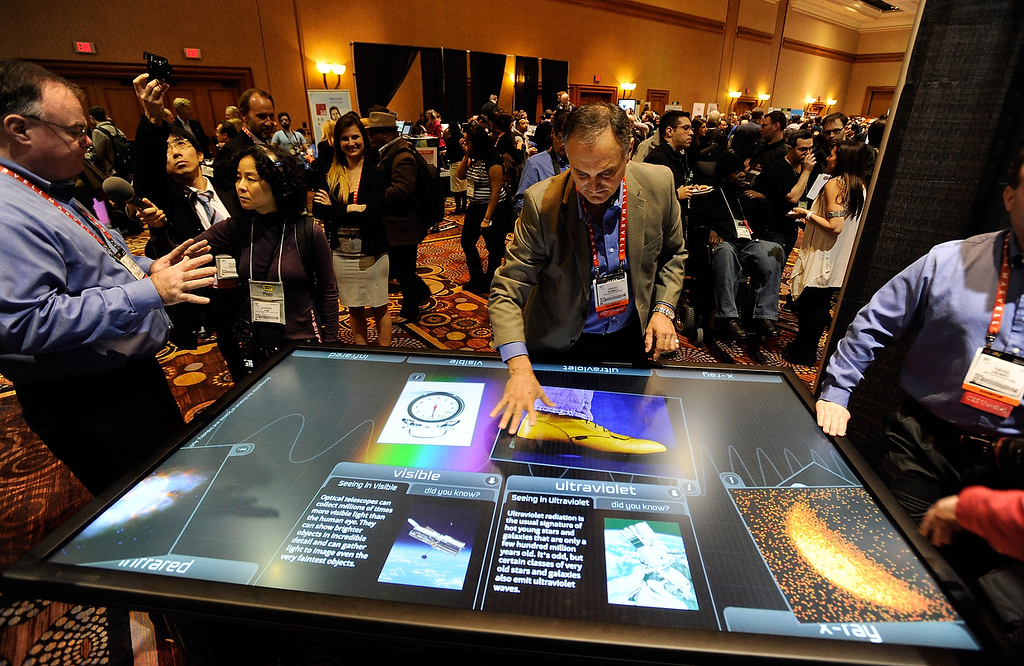 . Diego Romeu of 3M Touch Systems uses an 84 inch touch table during a press event at the Mandalay Bay Convention Center for the 2013 International CES on January 6, 2013 in Las Vegas, Nevada. (Photo by David Becker/Getty Images)