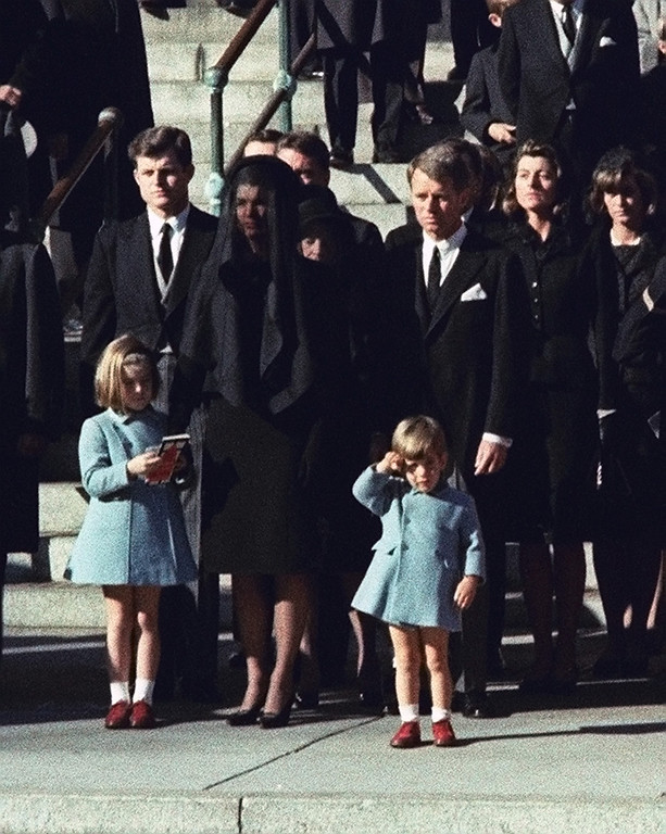 . Three-year-old John F. Kennedy Jr. salutes his father\'s casket in Washington on Nov. 25, 1963, three days after the president was assassinated in Dallas. Widow Jacqueline Kennedy, center, and daughter Caroline Kennedy are accompanied by the late president\'s brothers Sen. Edward Kennedy, left, and Attorney General Robert Kennedy. (AP Photo)
