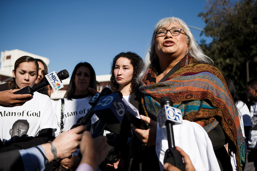 . Gina Gates, right, a relative of Luis Ricardo Hernandez, the apartment complex maintenance worker who allegedly shot to death a man he suspected of committing a series of burglaries at the apartment complex, speaks to the media in front of the Santa Clara County Hall of Justice prior to Hernandez\'s court appearance on Jan. 18, 2013 in San Jose. (Dai Sugano/Staff)