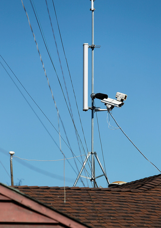 . A video camera sits atop Everett Basham\'s house on Humbolt Ave., in Santa Clara, Calif. on Wednesday, Feb. 13, 2013.   (LiPo Ching/Staff)