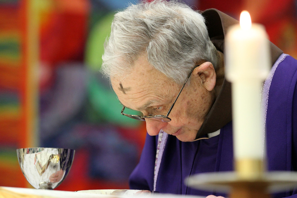 . Father Larry Dunphy, O.F.M. bows in prayer during Mass on Ash Wednesday at the Mercy Retirement & Care Center in Oakland, Calif. on Wednesday, Feb. 13, 2013.  Father Larry, a Franciscan Priest,  comes to the Senior Care Center to deliver Mass for the many seniors who are unable to travel outside of the center.  Mass is delivered every Sunday at the center where the average age is 91 years old and 90% of the residents are catholic.  During Lent, they will have Stations of the Cross prayer service every Friday at 2:00 pm. (Laura A. Oda/Staff)