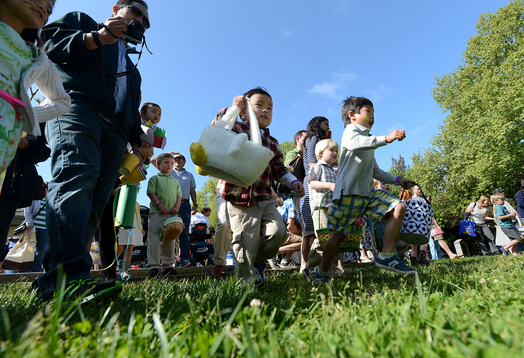 """. Children dash after Easter eggs during the Town of Danville\'s \""""Eggstravaganza\"""" held at the Danville Community Center in Danville, Calif., on Saturday, April 12, 2014. The event featured egg hunts for children of all ages as well as fun activities and snacks. (Dan Honda/Bay Area News Group)"""