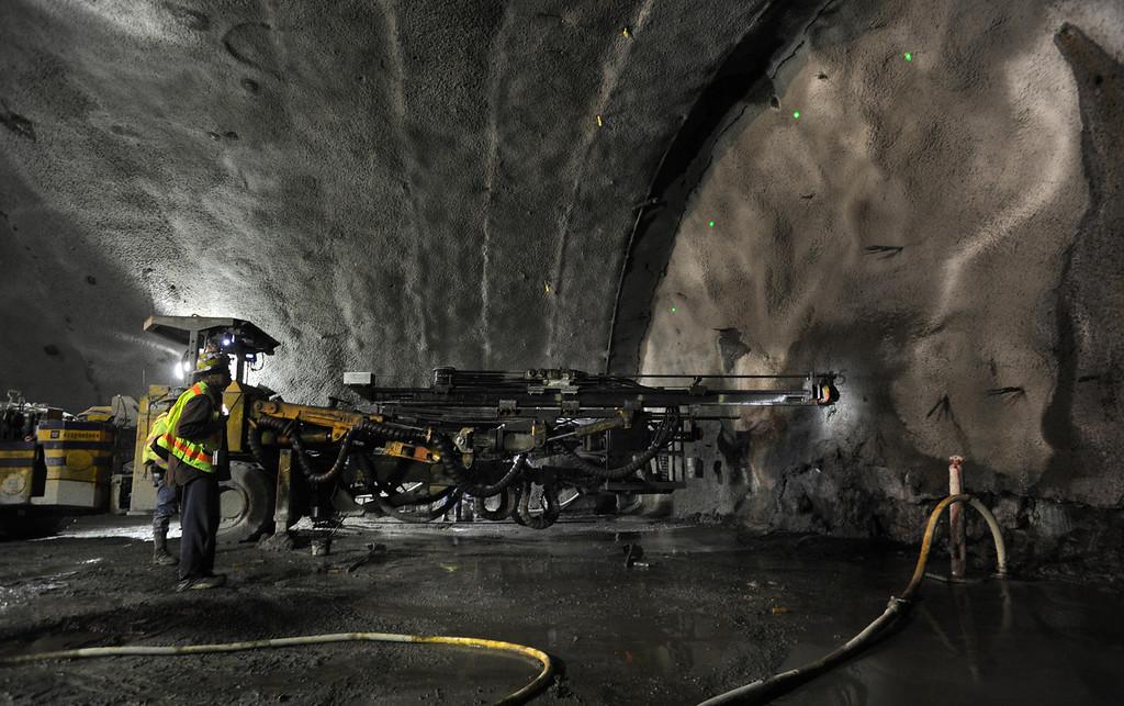 . Caltrans contractors from Tudor-Salida drill a probe into the face of the Caldecott Tunnel excavation 1200 feet into the Berkeley hills near Orinda, California Monday March 28, 2011.   (Karl Mondon)