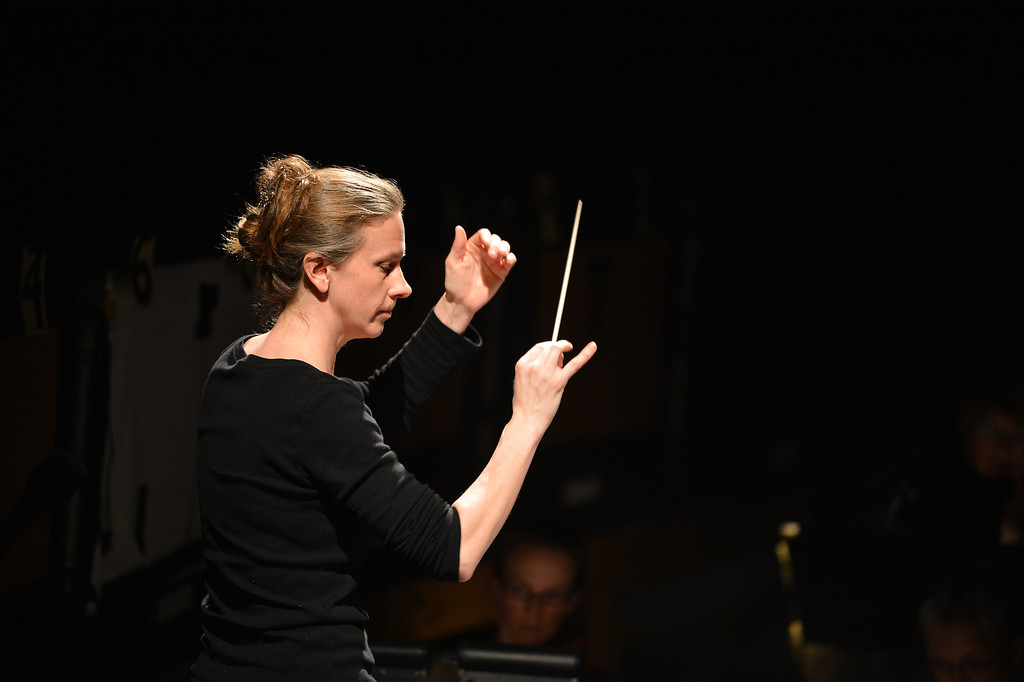 """. Sara Jobin conducts the orchestra during a rehearsal for a collaborative production of \""""The Secret Garden\"""" by Cal Performances and S.F. Opera at Zellerbach Hall on the University of California campus in Berkeley, Calif. on Wednesday, Feb. 27, 2013. (Kristopher Skinner/Staff)"""