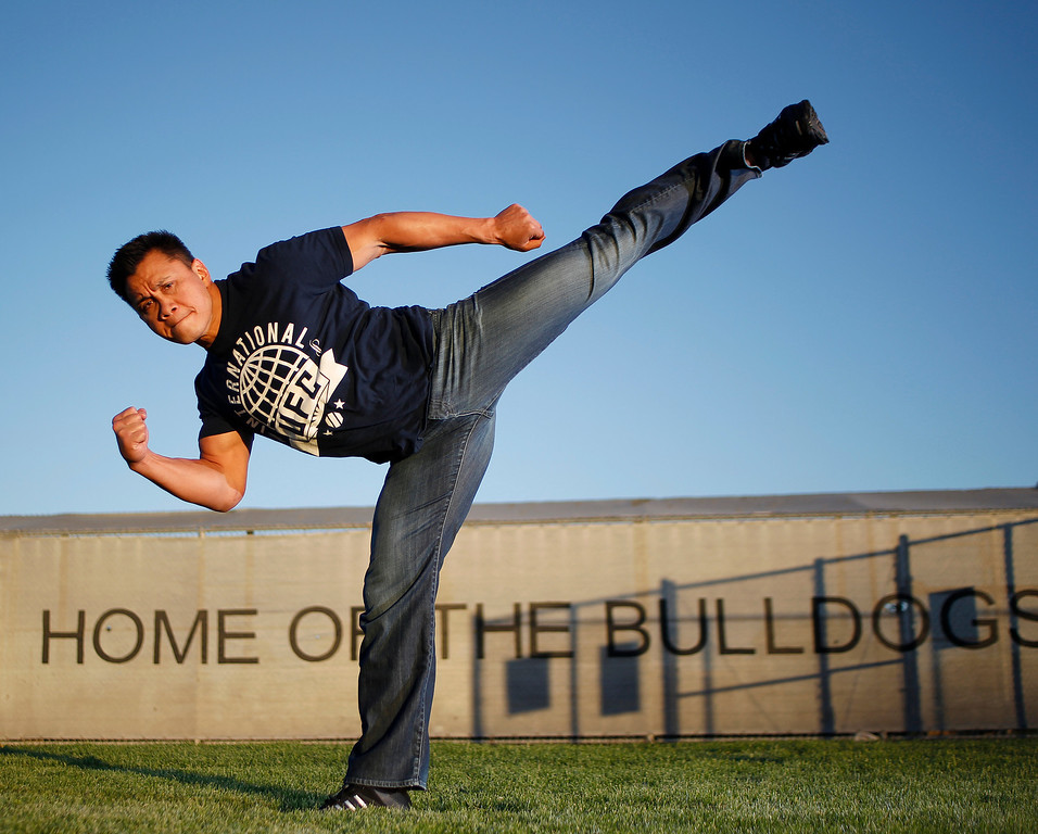 . Portrait of mixed martial artist Ultimate Fighting Championship and actor Cung Le, 41, demonstrating a side kick. Cung Le is an immigrant from Vietnam and member of Class of 1990 at San Jose High School athletic grounds in San Jose, Calif. on Thursday, May 30, 2013. (Josie Lepe/Bay Area News Group)