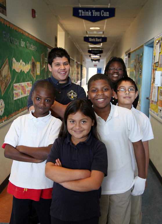 . Peres students, front from left, Raashad Kelly, 9, Ashley Santoyo, 10, Jeweldari Mayweather, 10, Ivan Castillo, 10, back from left, Marc Huerta, 12, and Linda Scruggs, 12, are all student at Peres Elementary School in Richmond, Calif., photographed on Friday, Feb. 8, 2013.  Peres school is one of two elementary schools in Richmond that have raised their average API test scores to over 800. (Laura A. Oda/Staff)