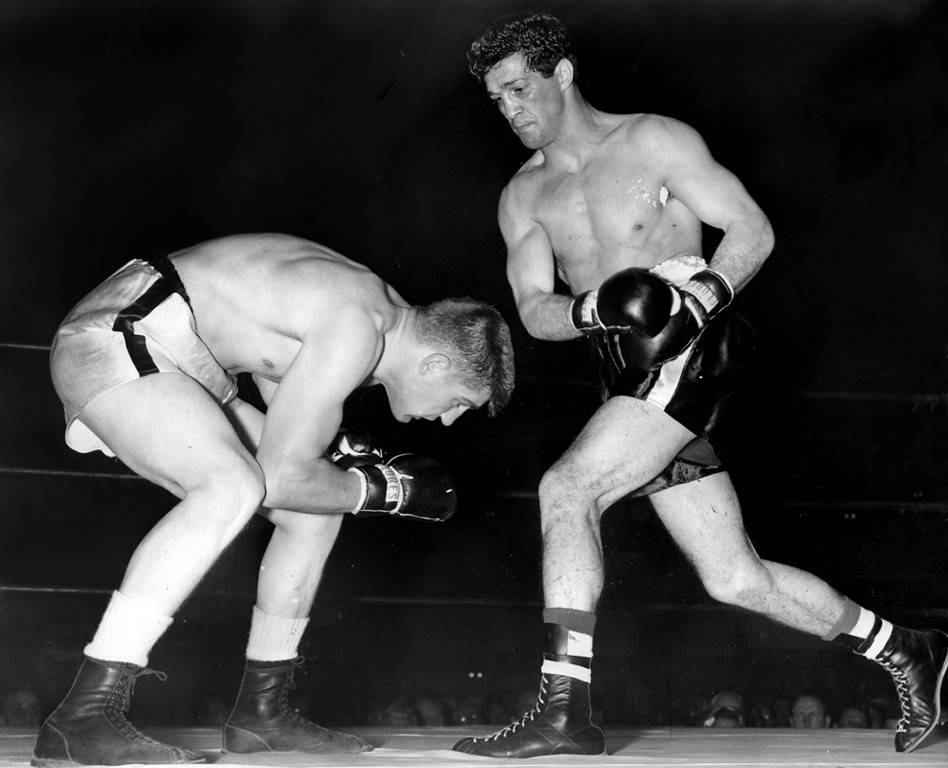 . March 19, 1957 - Joey Giambra (right) misses a right hand to the head of Al Andrews during the second round. (Chris Kjobech / Oakland Tribune)
