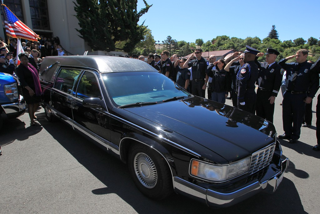 . Firefighters and paramedics from all over the Bay area salute the hearse during funeral services for Santa Clara paramedic Quinn Boyer, 34, of Dublin, at St. Theresa Catholic Church in Oakland, Calif., on Tuesday, April 16, 2013.  (Jane Tyska/Staff)
