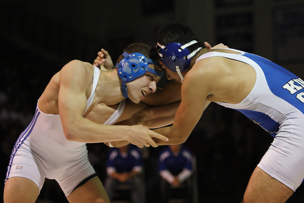 . Pioneer\'s Grant Biral, left, battles King City\'s Luis Quintero in his loss in the 160 pound class during the CCS wrestling championships at Independence High School in San Jose, Calif. on Saturday, Feb. 23, 2013. (Jim Gensheimer/Staff)