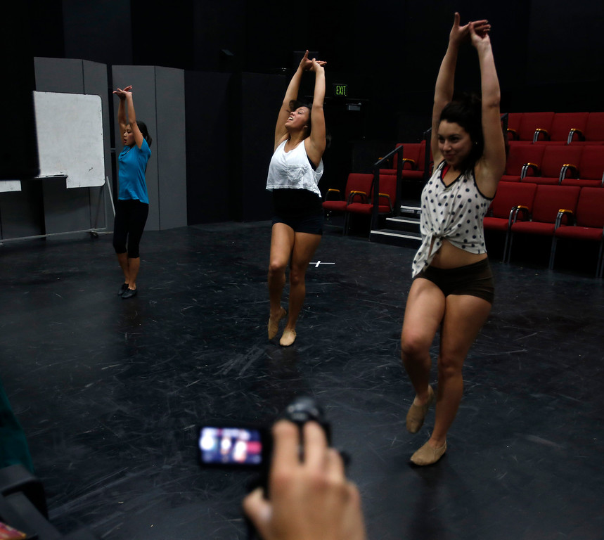 . From left to right, Angelique Gorospe, left, Marissa Gomez, center, and Marissa Dutra, right, are video taped during a dance audition during a casting call for Great America theme park for their various characters and dancers in Hall Todd Theatre at San Jose State University on Wednesday, Feb. 6, 2013.  (Nhat V. Meyer/Staff)