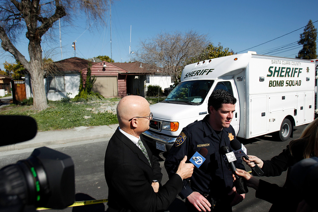 . Officer Sean Kennedy of the California Highway Patrol speaks to media during the search for explosive materials at Everett Basham\'s house on Humbolt Ave., in Santa Clara, Calif. on Wednesday, Feb. 13, 2013.   (LiPo Ching/Staff)