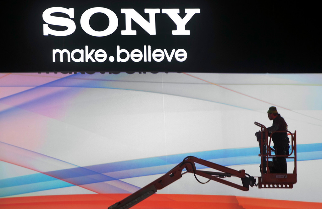 . A man rides a lift in the Sony booth as workers prepare for the International CES at the Las Vegas Convention Center in Las Vegas, Nev., on Jan. 5, 2013. (REUTERS/Steve Marcus)
