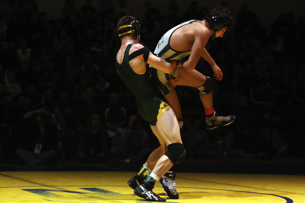 . Livermore\'s Nicolas Lang, left, wrestles De La Salle\'s Payton Russum in the 145-pound finals at the North Coast Section wrestling championships held at Newark Memorial High School in Newark, Calif., on Saturday, Feb. 23, 2013. Lang would get the win. (Anda Chu/Staff)