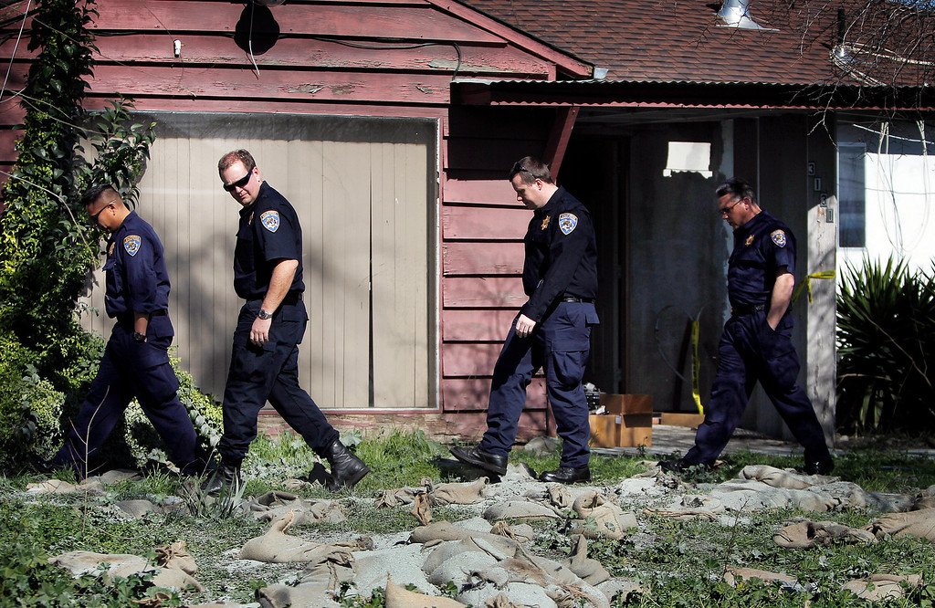 . Members of  the California Highway Patrol walk in front  Everett Basham\'s house on Humbolt Ave., during the search for explosive materials in Santa Clara, Calif. on Wednesday, Feb. 13, 2013.   (LiPo Ching/Staff)