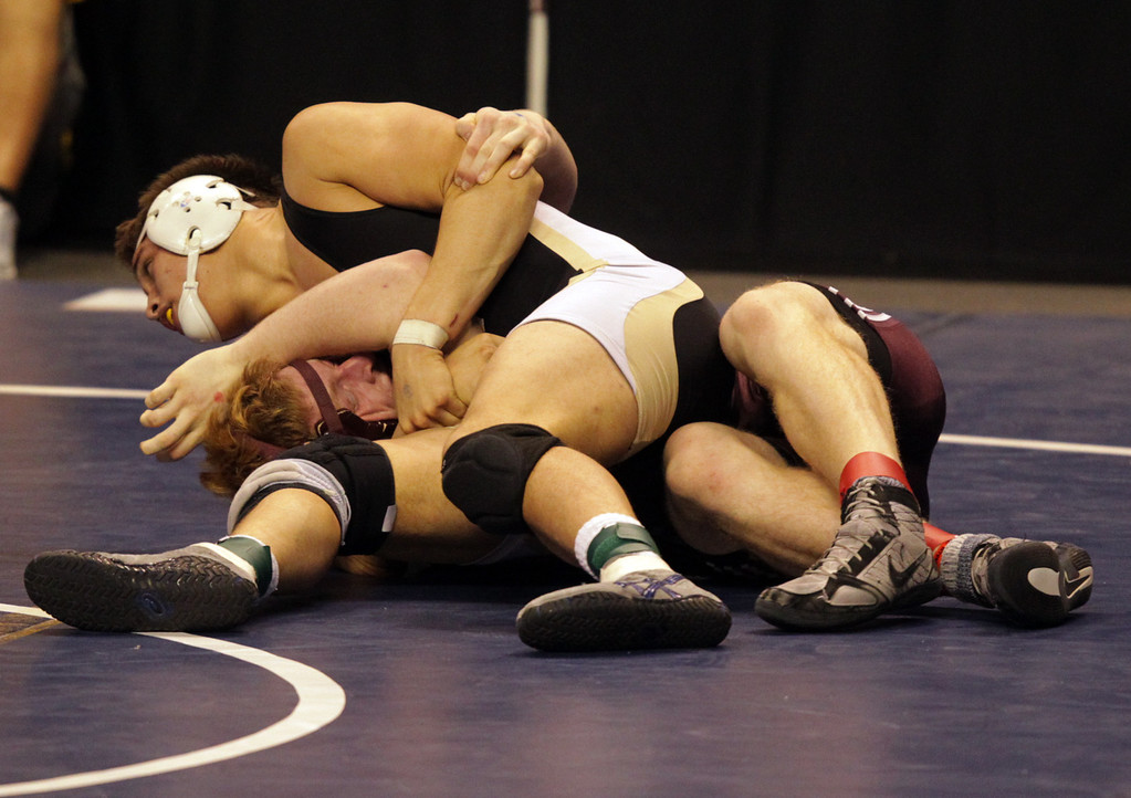 . Mitty\'s Chandler Ramirez, top, in control against West Campus\' Jordan Colby in a 195-pound second round match during the California Interscholastic Federation wrestling championships in Bakersfield, Calif., on Friday, March 1, 2013. Ramirez would go on to win the match and advance to the third round. (Anda Chu/Staff)