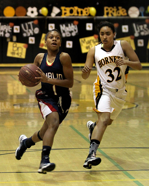 . Dublin\'s Milan Moses (1) drives past Alameda\'s Deja Johnson (32) in the first half of a North Coast Section Division II quarterfinal playoff game at Alameda High in Alameda, Calif., on Friday, Feb. 22, 2013.  (Ray Chavez/Staff)