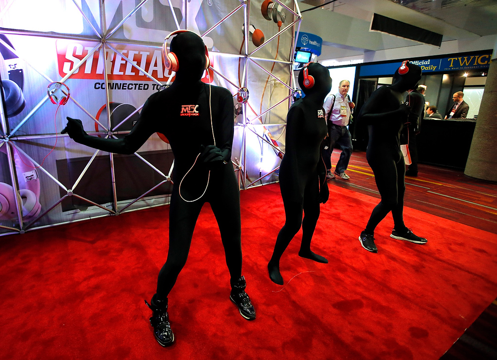 . Dancers perform at the MTX Audio booth at the International Consumer Electronics Show in Las Vegas, Tuesday, Jan. 8, 2013. (AP Photo/Jae C. Hong)