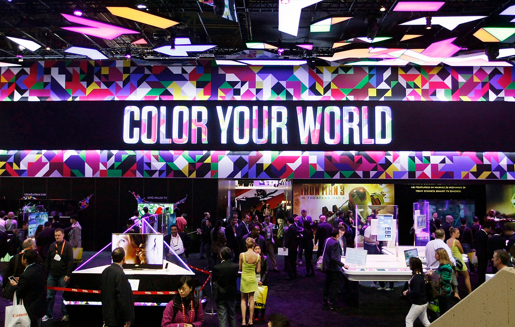 . Show-goers visit the booth of Chinese TV maker TCL on the first day of the Consumer Electronics Show (CES) in Las Vegas January 8, 2013. (REUTERS/Rick Wilking)